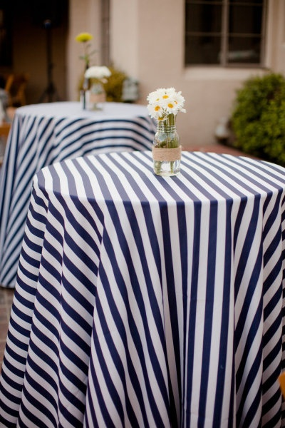 navy and white stripe tablecloths and  cheerful daisies #nautical