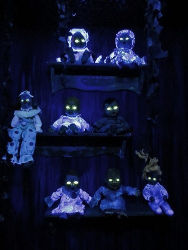 Haunted doll room.  I used Dayglo UV yellow paint for the eyes.  It almost looked like there was a light bulb inside each of them!