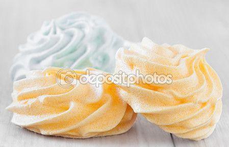 Closeup of yellow and green meringue cookies.