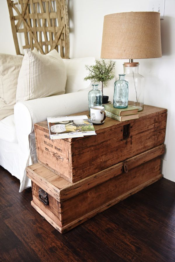 Lovely neutral cottage style living room - stacked trunk end table. Cozy rustic farmhouse style. For hearth?