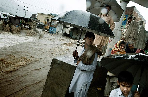 Floods in Pakistan  Photograph by Massimo Berruti / Agence VU for TIME  A town is split in half by floodwaters in late July.