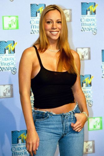 Mariah Carey 1999 started the trend of jeans with the waistband cut off, so that the zipper was the only way to keep them up