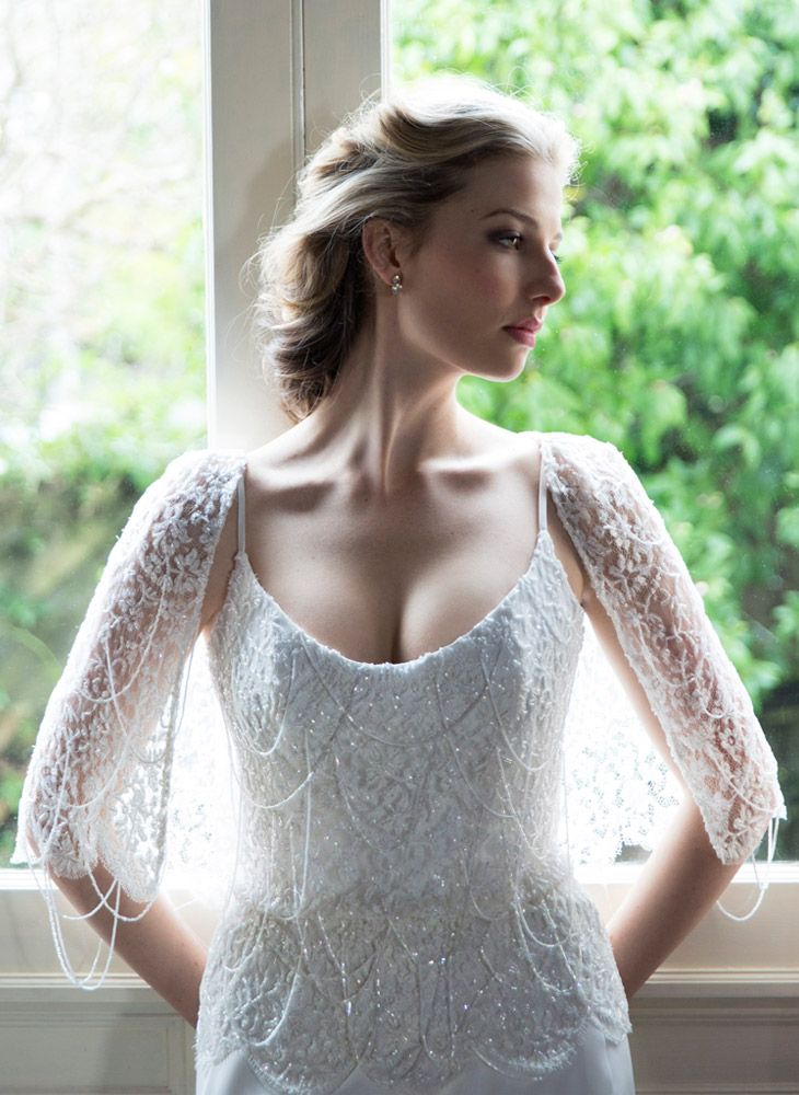 A beautiful beaded wedding dress and exquisite draped-back caplet created in French couture lace is beaded with hanging chains of cut crystals. View this #beautiful #lace #weddingdress by #AnnaSchimmel on: http://www.annaschimmel.co.nz/dress/beautiful-beaded-wedding-dress/