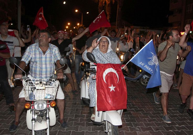 Turkey coup attempt: People march with Turkish flags in the resort town of Marmaris, Turkey. (Source: Reuters)