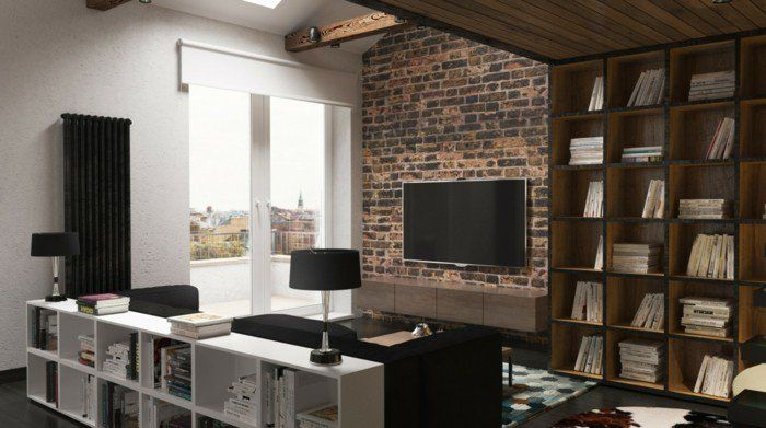 meubler un studio 20m2, mur en birques décoratifs en marron, canape noir