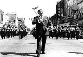 Meridith Wilson, composer of The Music Man, leading a parade in Mason City, Iowa.
