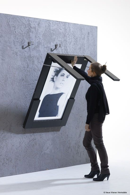 Drop down table doubles as framed art when up. Not practical but cool.