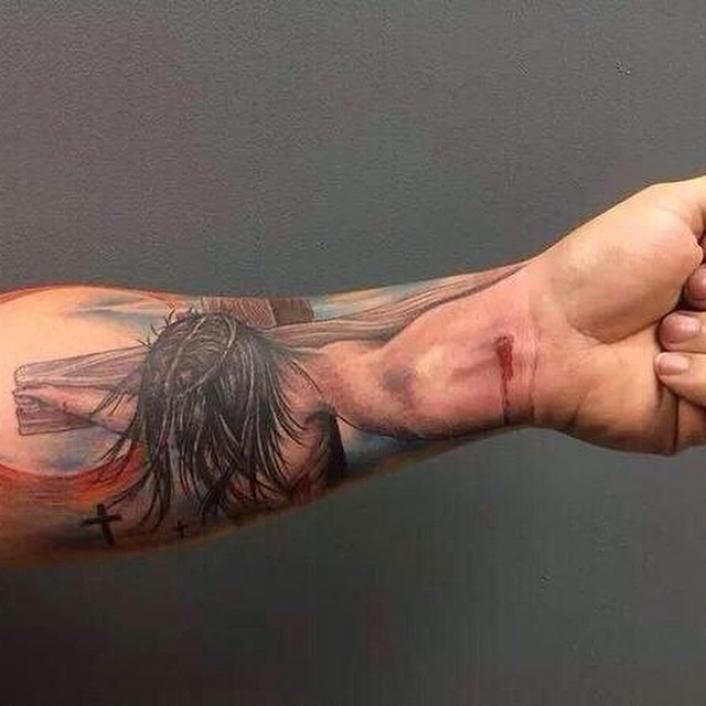 Hand of God: Creative Jesus Crucifixion Tattoo Goes Viral