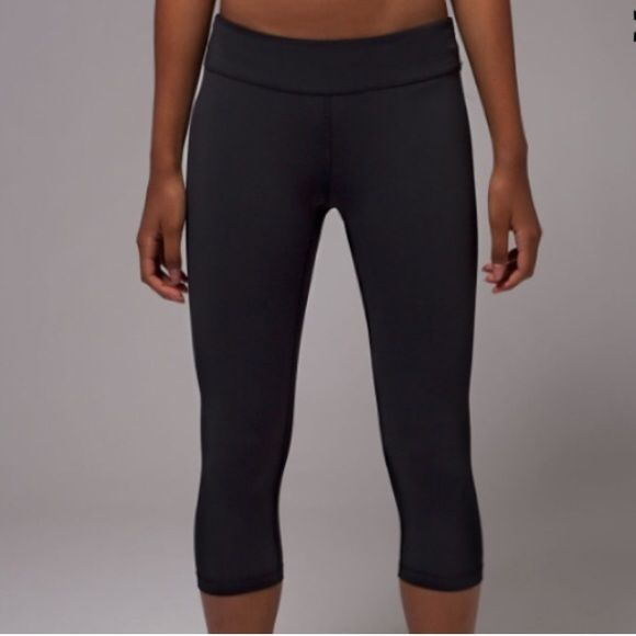 Lululemon Black Crops (Wunder Unders) These are Ivivvas (kids brand of lululemon)! Equivalent to Lululemon Wunder Unders.  I wore these three times before realizing they were too big. These are a size 14 kids, which is equivalent to a size 6. They are practically new and have no signs of wear.  (For reference I'm a size 4 in lulus and these were too big.) lululemon athletica Pants Leggings