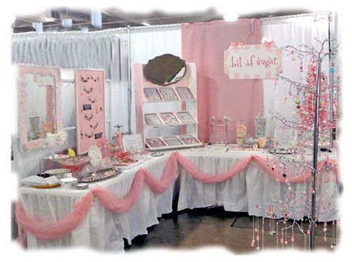 indoor craft fair display by bit of sugar--in love with the mirrors and pink garland.  Adorable.
