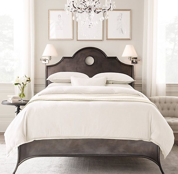 Light And Bright Bedroom. The Chandelier, Arched Metal Key Hole Bed, Swing  Arm