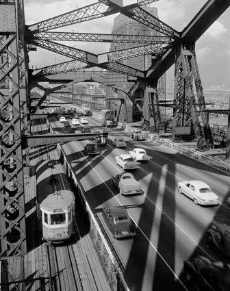 City bound traffic on Bradfield Highway, Sydney Harbour Bridge, 1953. Photographer: John Tanner. NAA: A1200, L16208