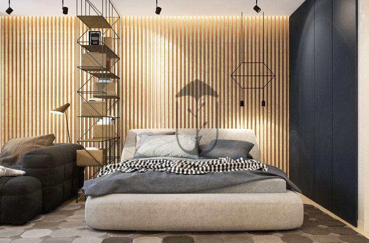 Зона спальни изолирована от рабочего места с помощью открытого стеллажа.