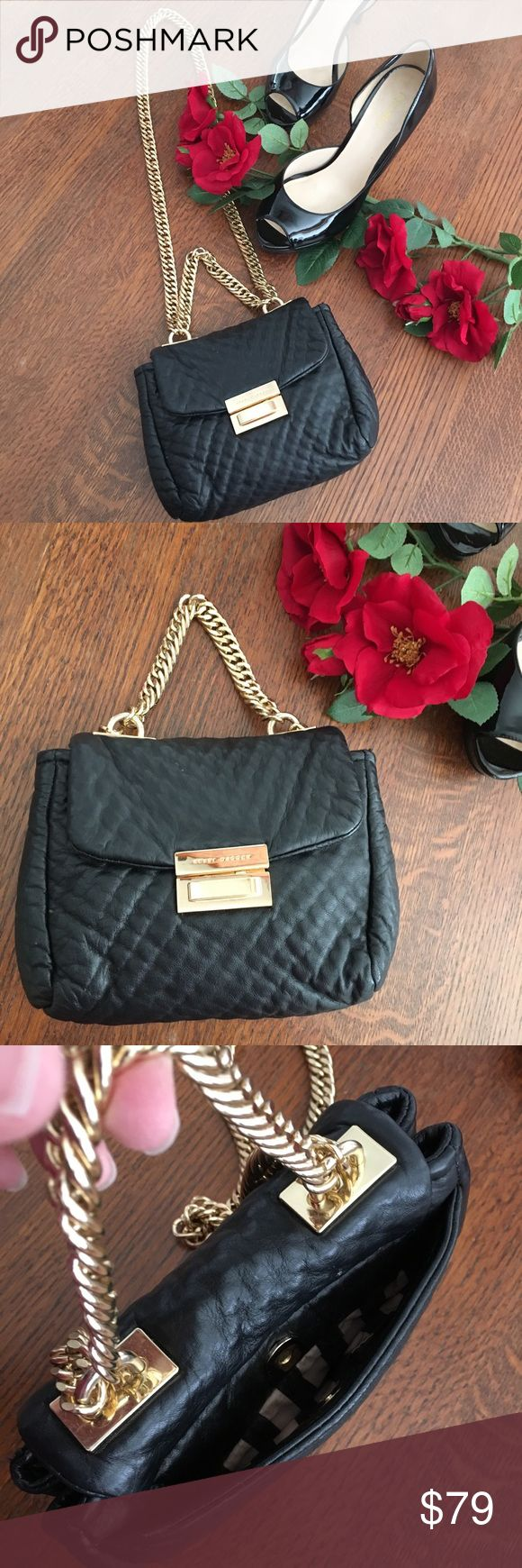 """🆕 Black Leather Bag Two thick gold chain handles. Use one hide the other in back magnetic closure pocket. Gold chain handles have a 4"""" drop & 17"""" drop. Bag measures 7"""" wide & 6"""" tall. Sides are 3.5"""" wide. Center zipper divider & one additional zipper pocket inside. Also two open pockets. Top flap has a gold slide buckle clasp. In excellent almost like new condition. Kelsi Dagger Bags Mini Bags"""