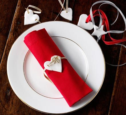 Peppermint & rose cream napkin decorations: These elegant edible adornments really finish off a beautifully set dinner table on those special occasions