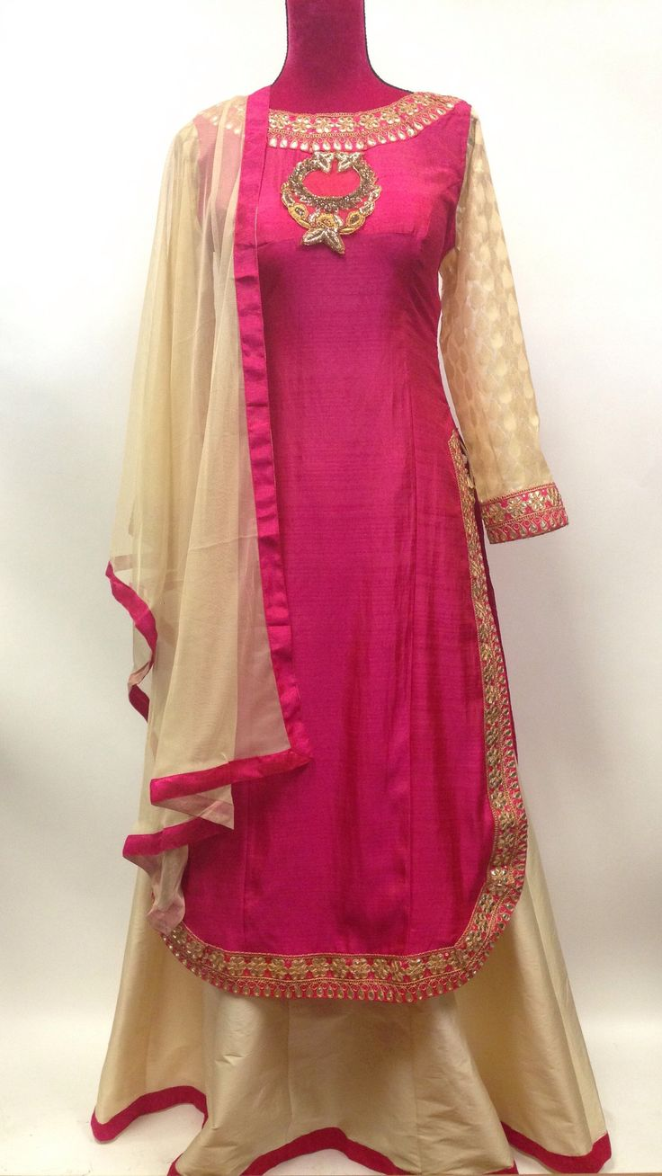 Pink and cream silk lehenga suit is made with glitzy foliage patterns enriched with fancy thread,beads,stones sequins work on stylish silk Kurta. Contrast plain cream silk skirt amplifies the look. Co