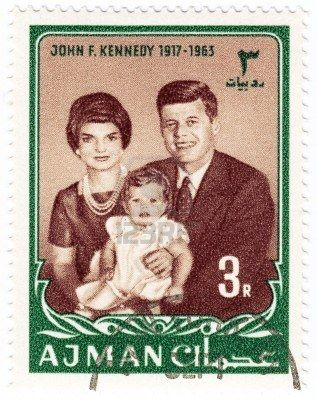 Ajman - 1965: Stamp printed in Ajman shows John Kennedy, wife Jacqueline and daughter Caroline.
