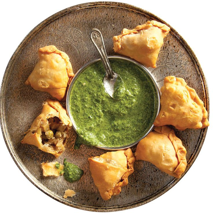 Fill classic Indian samosas, with a lively spiced potato and pea filling; then serve with a tangy cilantro-mint chutney.
