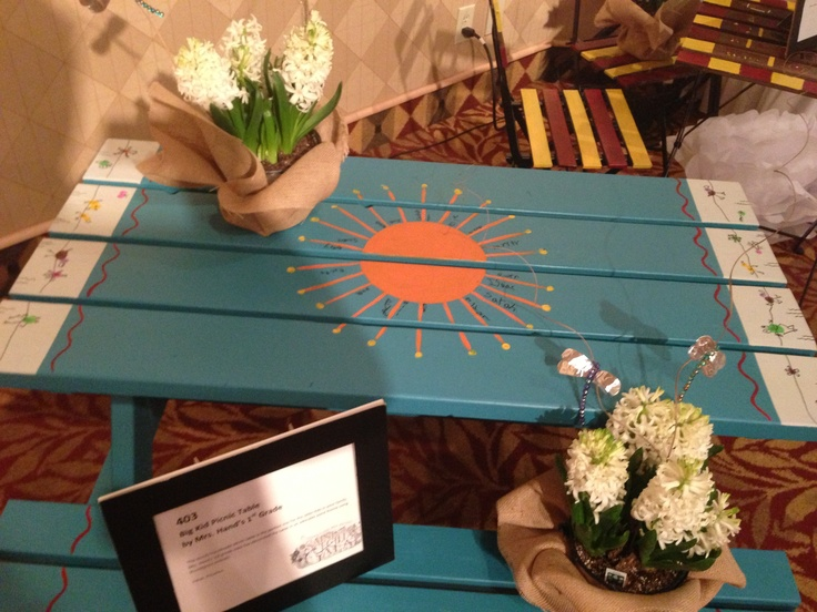 A fun take on the classic kids picnic table.  Really about the creative use of color.  An easy sell at any auction.