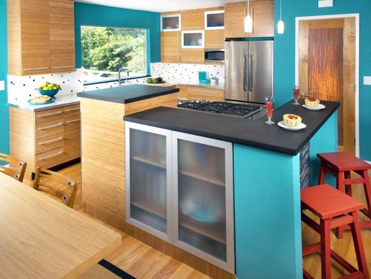 Designer Mollyanne Sherman gave this coastal kitchen an eco-friendly design with bamboo cabinets and Paperstone counter tops. Walls in a deep-sea turquoise evoke an ocean ambiance. Photography by Treve Johnson