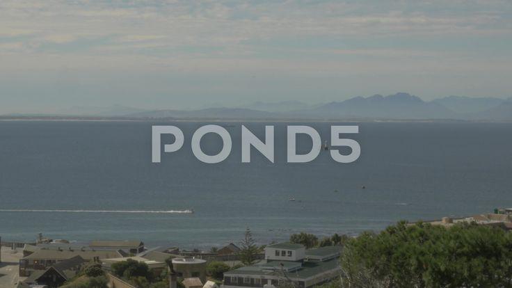 4k Speed Boat on Beautiful Blue Water Ocean Mountains In Background - Stock Footage   by RyanJonesFilms