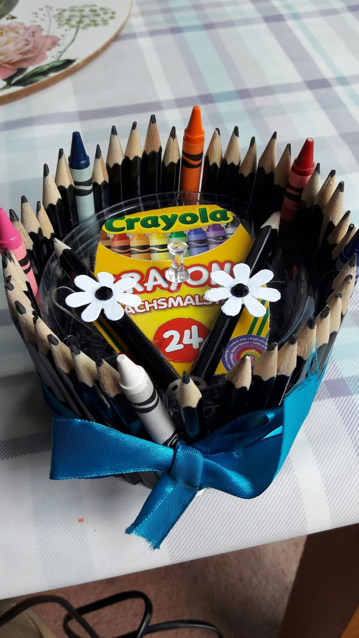 Thank you teacher idea. Secured pencils and crayons around a tin or stationary pack with a hot glue gun. For more craft ideas visit my page at let's make crafts #letsmakecrafts #homemadeteachergifts