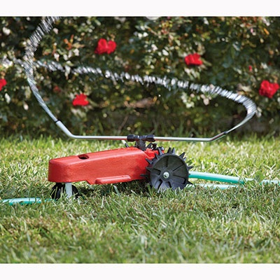 Traveling Tractor Sprinkler. Im not a kid, but this looks quite practical and unique.  I need one for my yard.