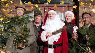 Bürgermeister Schönbiehl als Weihnachtsmann inmitten der anderen vier Büttenwarder.