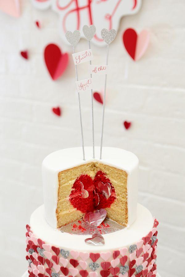 heart center and little surprises for you guests #weddingcake #cakeideas #weddingchicks http://www.weddingchicks.com/2014/01/28/heart-wedding-cake/