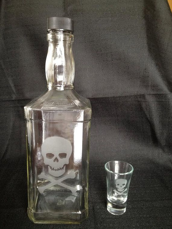 Shopping for men can be tough! Get him this one of a kind,1L, laser etched JD liquor bottle with a skull and crossbones pattern. Shot glass is etched to match. Perfect for that one of a kind gift for Valentine's day, anniversaries, best man gifts, a unique addition to any home bar, and whatever else you can think of. Etching is permanent and dishwasher safe