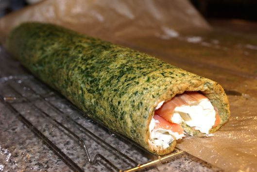 Rolled spinach and smoked salmon roulade with dill and cream cheese