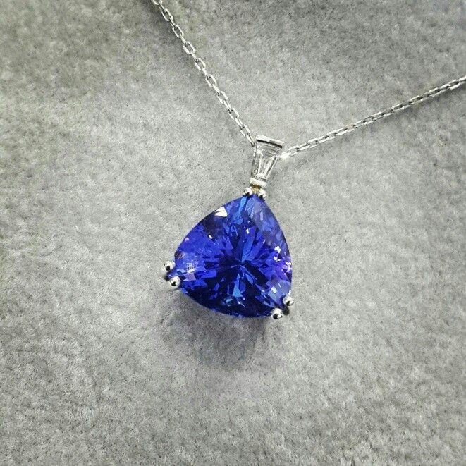 Africn - Tanzanite - Diamonds - Platinum  Trilliant Cut 4.55ct Tanzanite in a Handcrafted Diamond and Platinum Pendant.   #tanzanite #platinum #handcrafted #africndiamonds #africn
