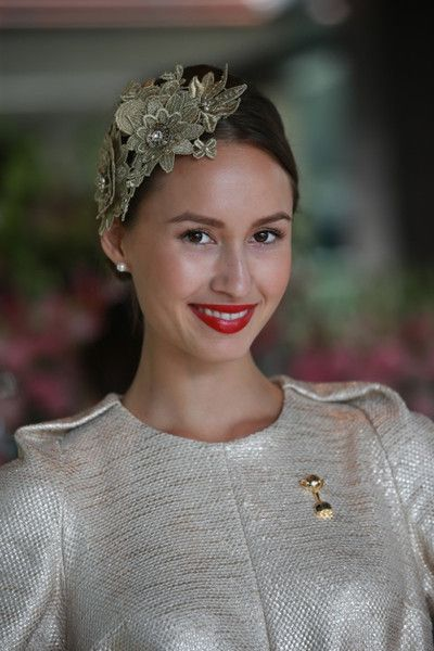 Chloe wears a bespoke Natalie Chan headpiece the 'Golden Girl'