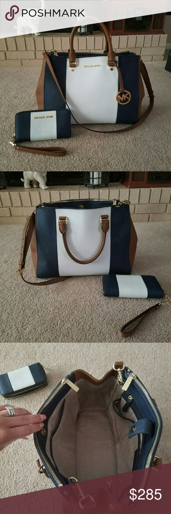 Michael Kors Sutton Set Authentic MK Sutton Saffiano Center stripe/Colorblock large w/ matching zippy tech wallet/wristlet. Colors R Navy,luggage & white.Both in Excellent used condition.only flaw on purse is zipper pulls have tiny spots at base where gol