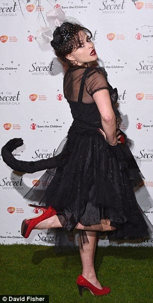 She's just a pussycat: The Harry Potter star added her own twist to her frock with a tail ...