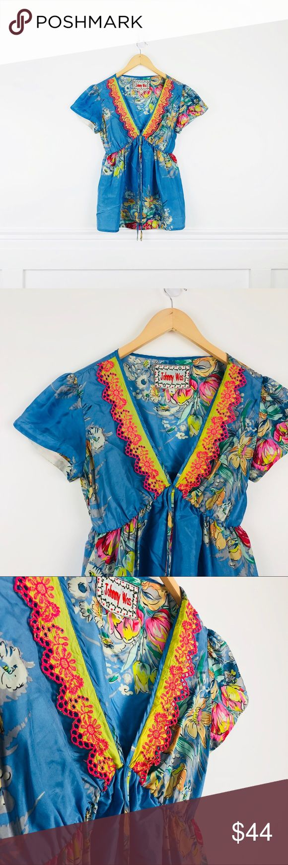 "Johnny Was silk blouse Johnny Was 100% silk empire silhouette blouse in blue floral print. Deep lime v-neckline with hot pink eyelet trim and drawstring bow. Size S. Chest 18"", length 25"".  In great used condition, last photo shows a stain on the left side of the neckline, by the shoulder seam. Johnny Was Tops"