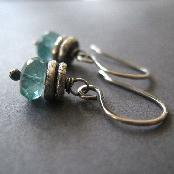 Aqua blue Apatite along with a handmade Fine Silver rondelles make up these dangle earrings. The Fine Silver has been melted and formed into handmade rondelles. They hang from handmade sterling silver earwires. The earrings have been oxidized and hand polished to bring out details and a rustic look. All handmade by me.    The Apatite measure 7 mm.  The Earrings measure 1 inch.    Comes in a gift box.    More Fine Silver Jewelry in my shop...  https://www.etsy.com/shop/lori...