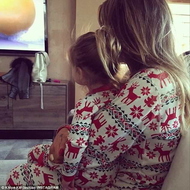 Cuddle time: Khloe posted a picture of herself and her niece Penelope in matching winter p...