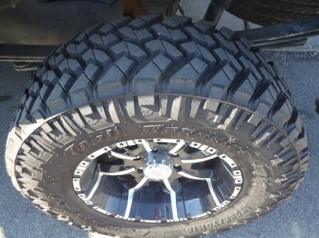Nitto trail grappler mud terrain 35x12.5x18's I have these and love them!! They'll last way longer then toyo open country