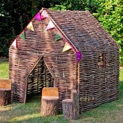 Browse our perfect hazel playhouses and outdoor kids furniture at the Farthing, with free delivery available, made in the UK from eco friendly Hazel.