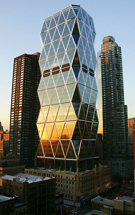 This 46 stories tall, Hearst Tower was the first skyscraper to break ground in New York City, standing 182 meters (597 ft) with 80,000 sq metres of office space. The elegant lines of the new building's outer grid will encase a series of glass panels, each four stories tall, that together make up more than one mile of windows.