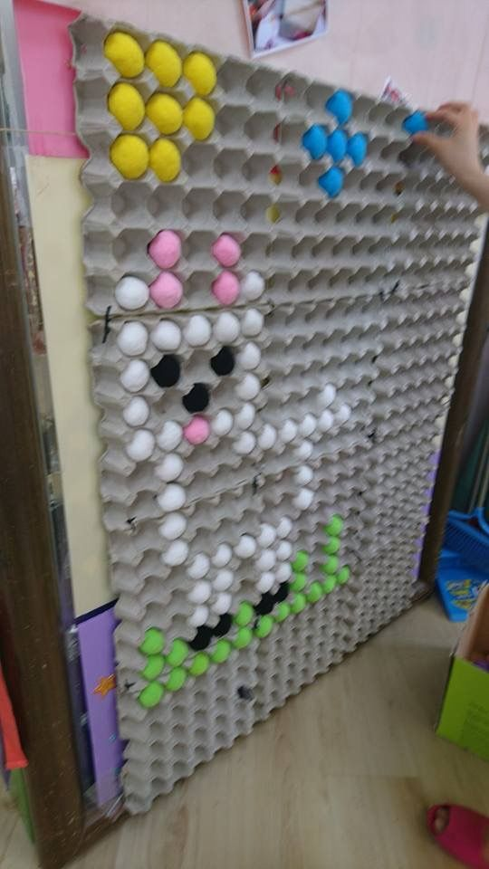 Egg cartons and (looks like) pom poms