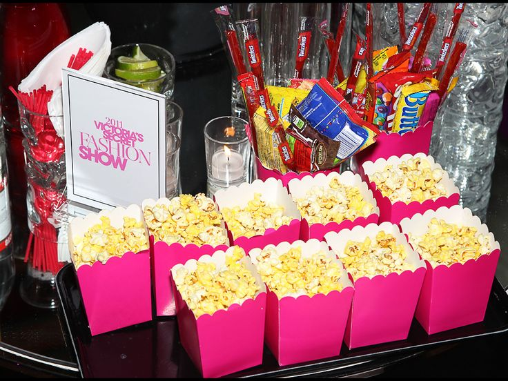 Popcorn on candy bar.  Pink M & M's.  Pretzels. Could be cute for VS Fashion show viewing party
