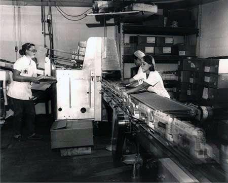 Working on the conveyor belt, Maple Donuts, York Pennsylvania.