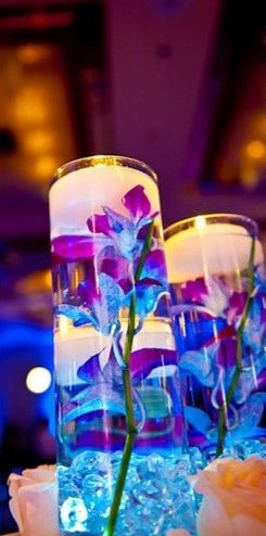 Centerpiece idea, but with water beads Idea for vase  http://www.walmart.ca/en/ip/hometrends-glass-vase/6000016939644
