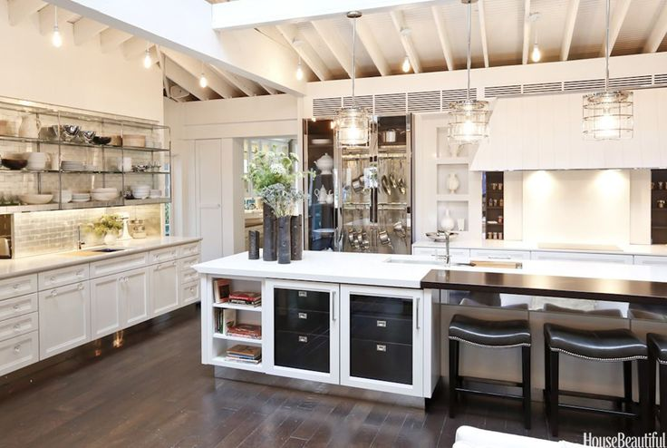 """Simple yet elegant, the 1,000-square-foot dream kitchen — showcased in New York's Rockefeller Center — is filled with glittering tile, glass knobs, a bold sink, and a jaw-dropping butler's pantry. """"Kitchens can get very complicated,"""" says designer Mick De Giulio. """"I wanted to keep this simple and classic. It's also a little bit glamorous."""""""