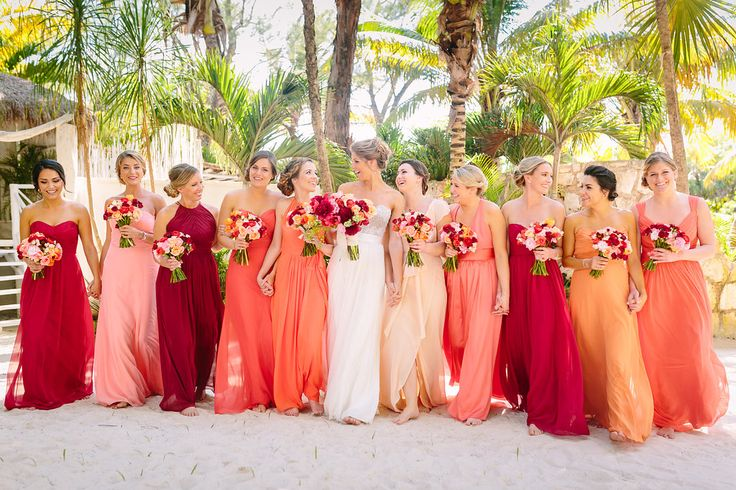 Beautiful sunset ombre  bridesmaids dresses. Beach Wedding in Tulum, Mexico | Photos by Brian Leahy.