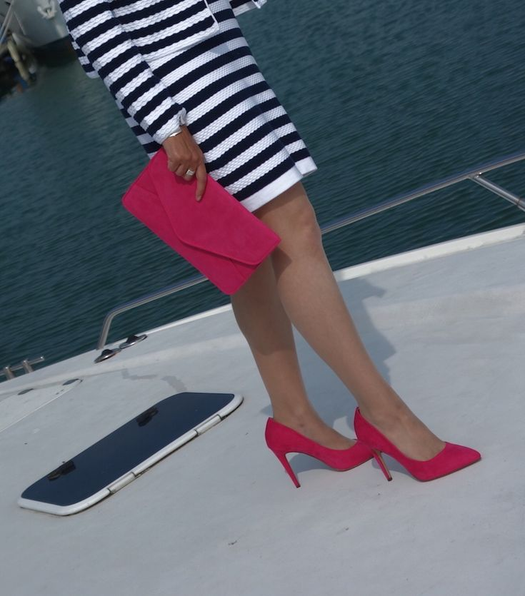 Nautical Stripes, Hot Pink Accessories And The Over 40 Collective | Over 40 Fashion | Teaming a nautical style blue and white striped jacket and blue and white striped dress with fuchsia accessories. The hot pink court shoes and hot pink clutch bag give the outfit an unusual twist and a pop of colour.