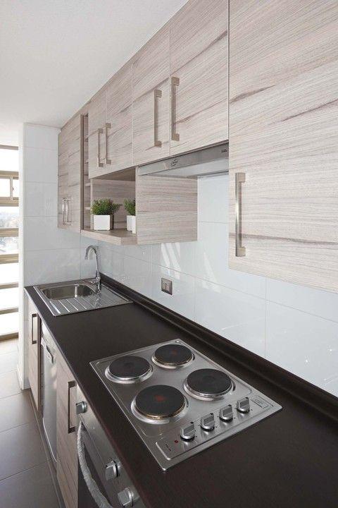 En esta oportunidad Masisa presenta los muebles de cocina fabricados con Fibromelamil y con diseño Nogal Ceniza empleados en el proyecto de Recoleta Plaza.