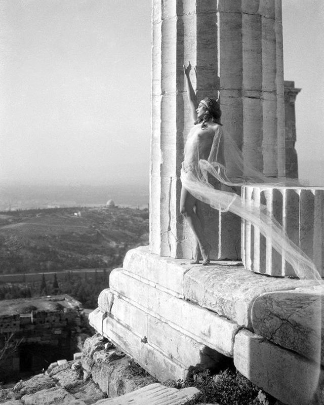 "Nelly Nikolska at the Acropolis / Nelly's view of Greece. Her photos appeared in official tourist publications circulated abroad contributing to creating the earliest visual symbols of Greece's ""philosophy regarding tourism"". She systematically depicted ancient monuments and sites. Her experiments with natural light and her photographs of ancient temples are still true masterpieces."